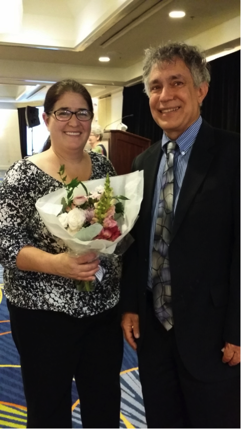 Governing Board Vice President Tim Nader congratulates Beverly Dominguez at the Soroptomist International of Coronado luncheon Saturday.