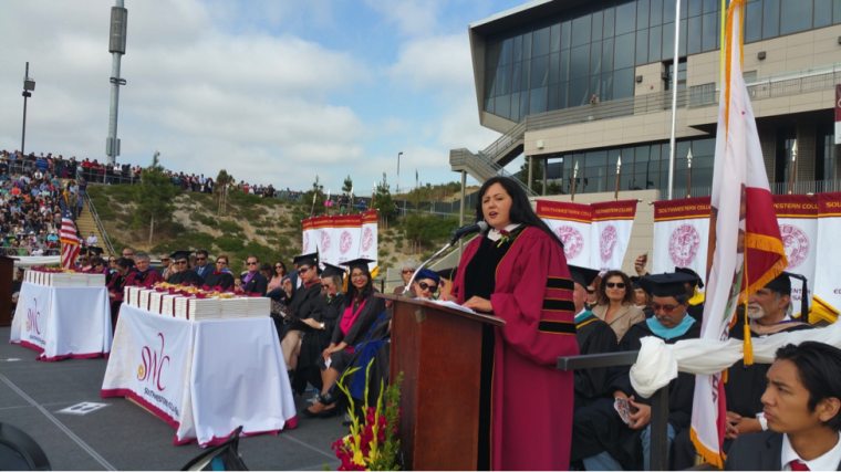 Governing Board President Nora E. Vargas address the graduates.