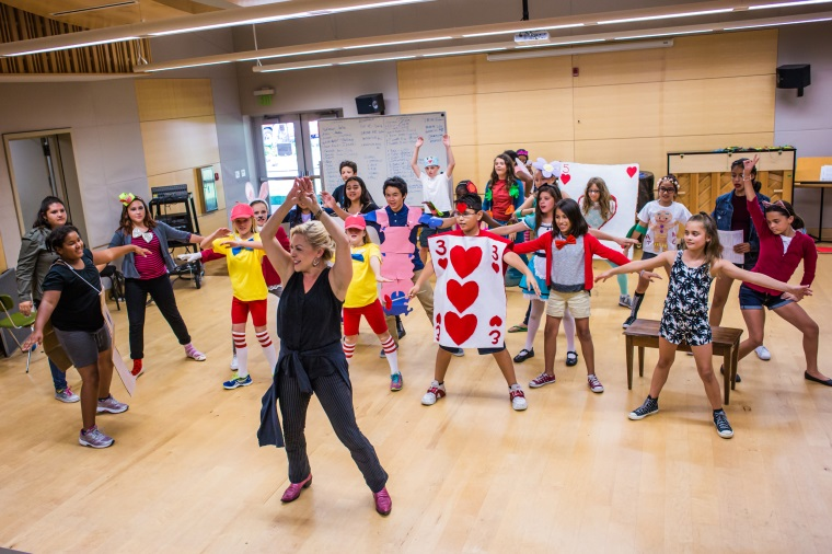 "Instructor Laura Hodge leads her ""Musical Theatre Camp"" class in a warm-up before their production of ""Alice in Wonderland."""