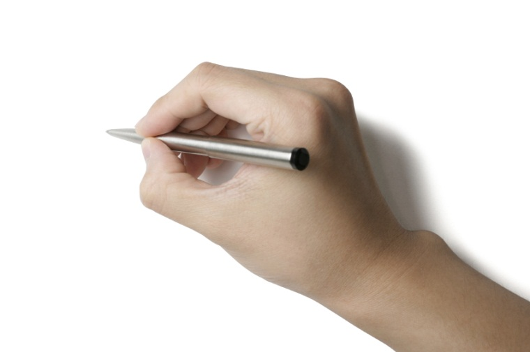 image of hand holding silver pen for writing