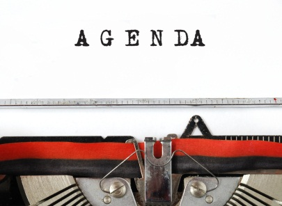 image of a typewriting typing the word agenda