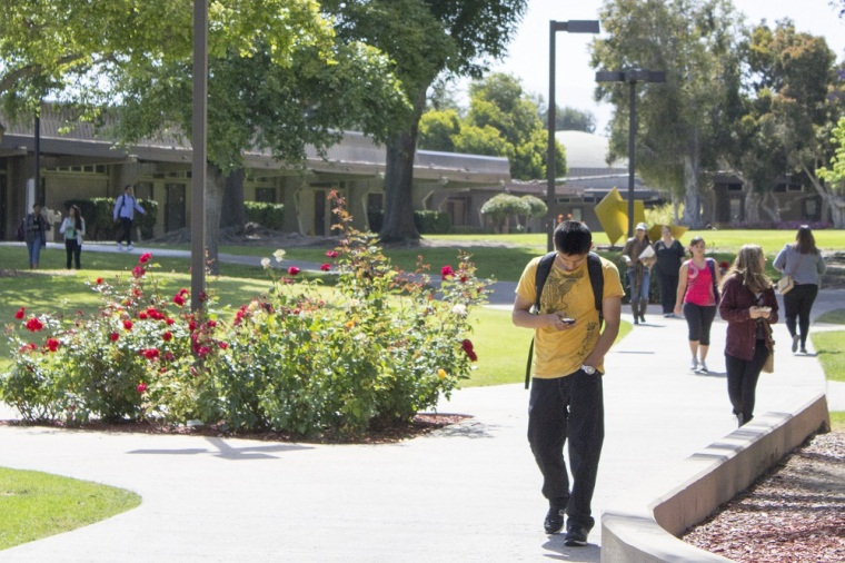 photo of students walking around campus