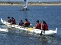 Students paddling an outrigger canoe