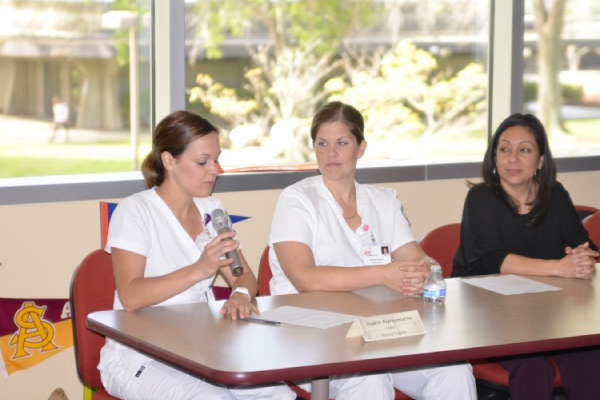 A photo of a discussion panel of two nursing students
